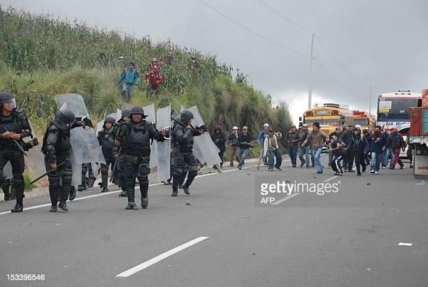 Riot police charge on demonstrators in the Santa Catarina Ixtahuacan municipality Solola departament 170 km west of Guatemala City on October 4...