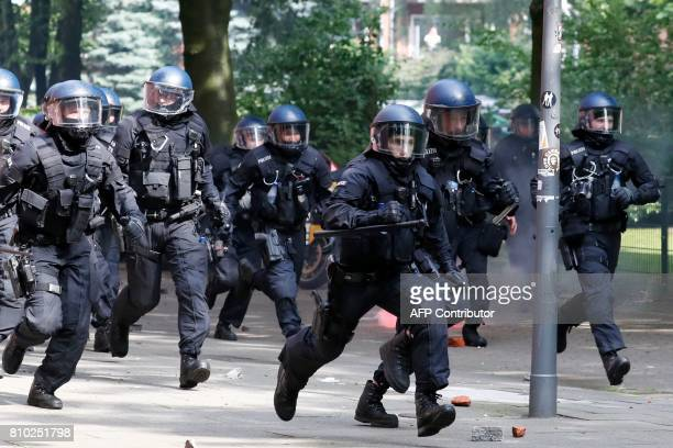 Riot police chase protesters on July 7 2017 in Hamburg northern Germany where leaders of the world's top economies gather for a G20 summit Protesters...