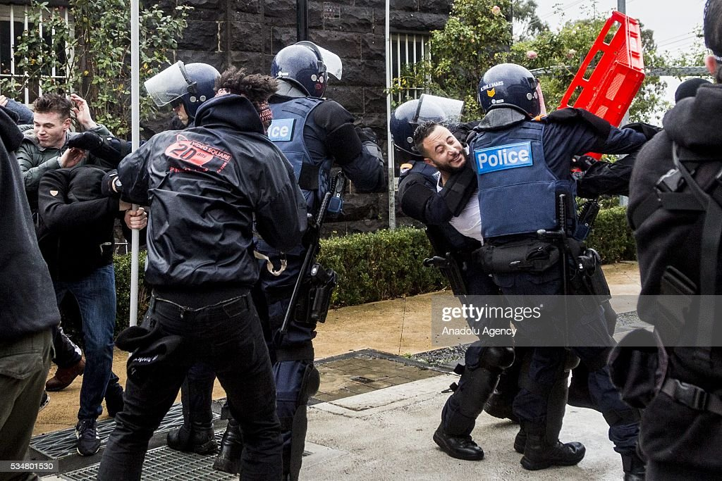 Riot Police clash with Anti Fascists and anti-racism protestors as they try to hold a police line during a 'Say No To Racism' protest and a counter 'Stop the Far Left' rally in Coburg Melbourne, Australia on May 28, 2016. Seven men were arrested after a violent brawl erupted between rival protesters at an anti-racism rally in Melbourne's inner-north. Anti-Facists clashed with Anti-Islam nationalists who go by the name 'True Blue Crew'.