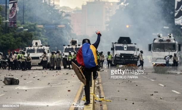 TOPSHOT Riot police clash with demonstrators during a protest against the government of President Nicolas Maduro in Caracas on May 20 2017 Venezuelan...