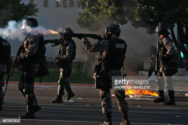 Riot police clash with demonstrators during the protest 'Occupy Brasilia' against the labor and social security reforms of his government in Brasilia...