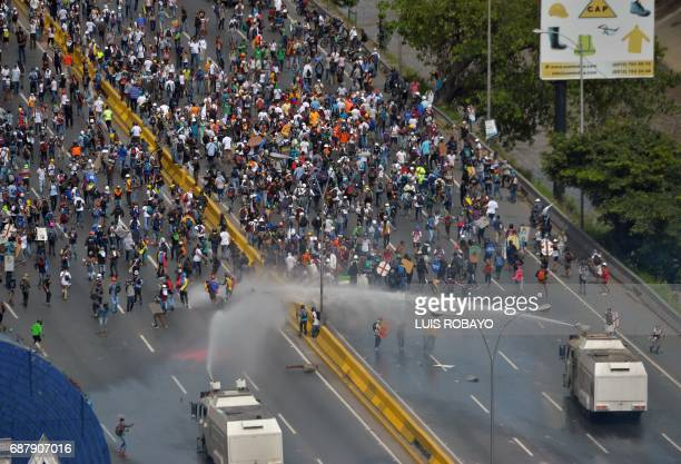 TOPSHOT Riot police clash with opposition demonstrators during a protest in Caracas on May 24 2017 Venezuela's President Nicolas Maduro formally...