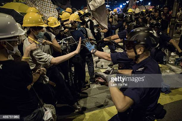 Riot police clash with prodemocracy protesters outside Central Government Complex at admiralty district on December 1 2014 in Hong Kong Leaders from...
