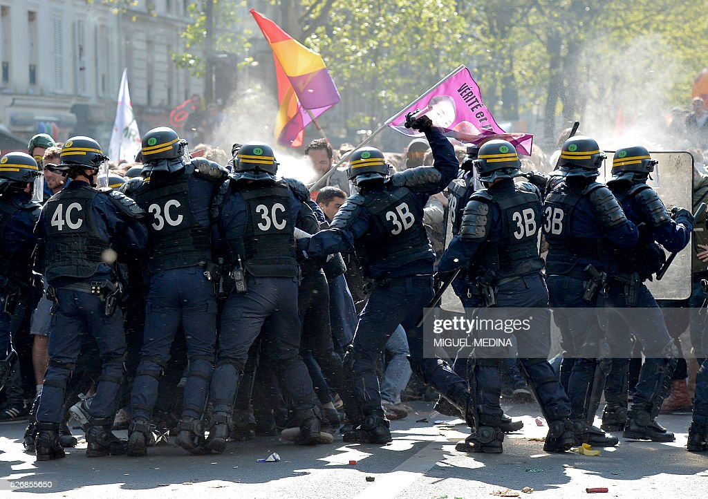 Riot police clash with protester at a traditional May Day demonstration on May 1, 2016, in Paris.