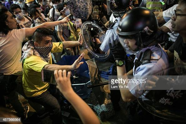 Riot police clash with protesters at Mongkok protest site after the crackdown in the morning on October 17 2014 in Hong Kong Hong Kong Police have...