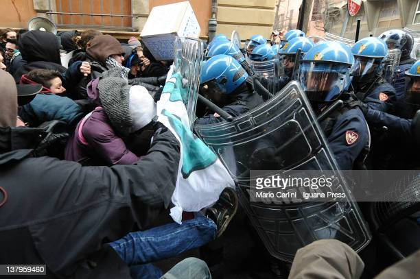 Riot police clash with protestors and students outside the University of Bologna on January 30 2012 in Bologna Italy Protestors were reacting in...