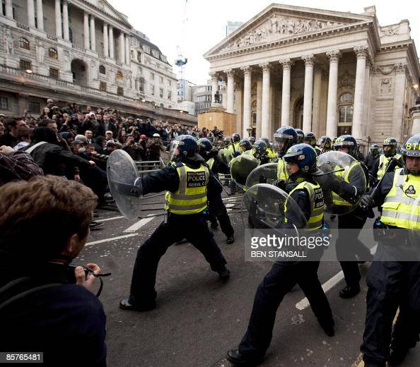 Riot police clash with protestors during an anti G20 demonstration near the Bank of England in London on April 1 2009 Violent clashes kicked off in...