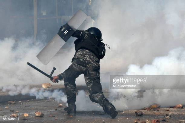 TOPSHOT Riot police clash with students from the National Autonomous University of Honduras gathered under the University Student Movement during a...
