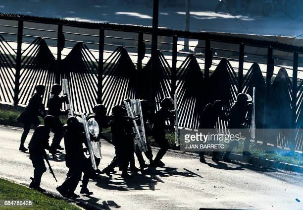 Riot police clash with Venezuelan opposition activists during a rally against the government of President Nicolas Maduro in Caracas on May 18 2017...