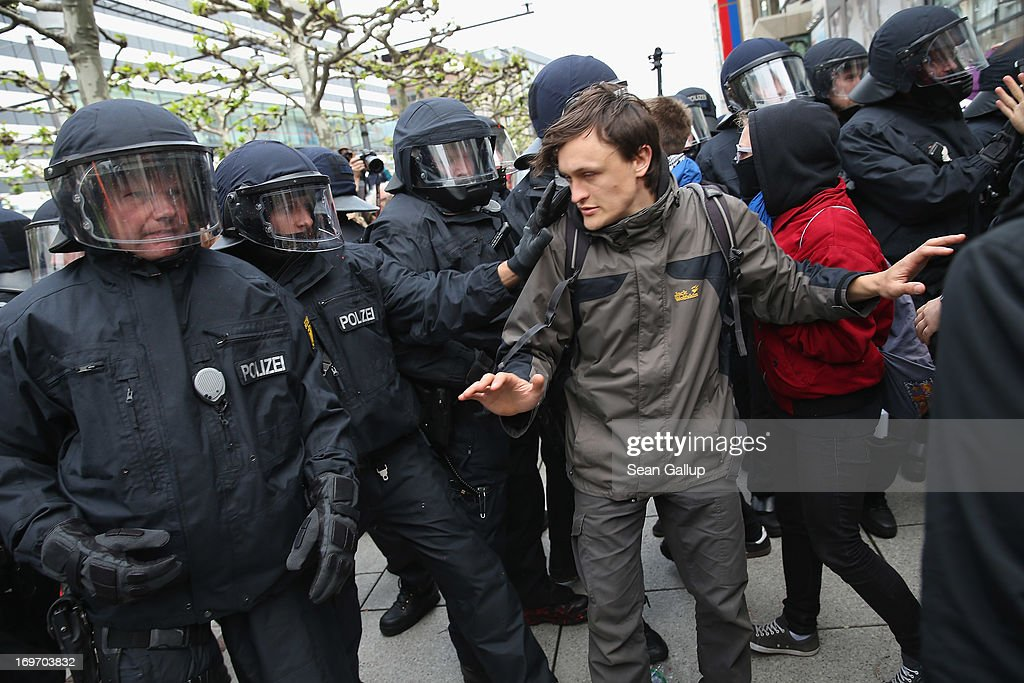 Riot police confront Blockupy protesters outside a clothing store in the Zeil pedestrian shopping street on May 31, 2013 in Frankfurt am Main, Germany. Several thousand protesters are taking part in Blockupy protests today and tomorrow in Frankfurt in order to demonstrate aginst ECB debt policy, food prices speculation by Deutsche Bank and the labor practices inherent in the discount clothing industry.