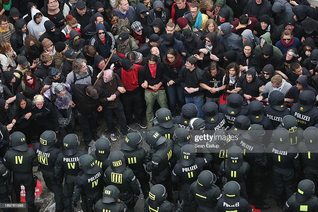 Riot police confront protesters during the main Blockupy demonstration in the financial district on June 1, 2013 in Frankfurt am Main, Germany. Thousands of protesters are marching to demonstrate against capitalism, European Central Bank debt policy and the exploitation of textile workers in Third World countries, among other issues.