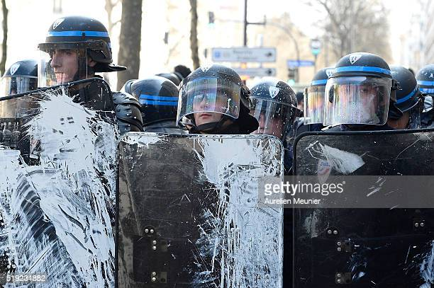 Riot police covered with paint during the parisian students demonstrate against the 'El Khomeri' law project on April 5 2016 in Paris France...
