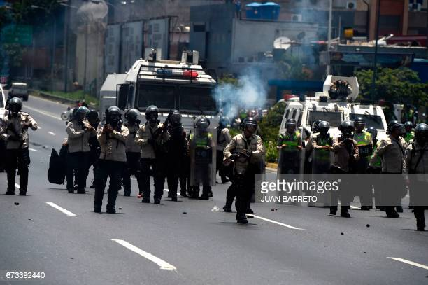 Riot police crack down on opposition demonstrators during a march in Caracas on April 26 2017 Protesters in Venezuela plan a highrisk march against...