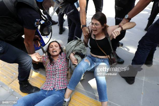 Riot police detain protesters outside a courthouse in Ankara on September 14 during the trial of two Turkish teachers who went on a hunger strike...