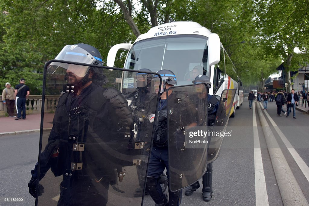 Riot police escort a bus out of the central bus station of Toulouse. It was blocked by several trade unions (SUD-Rail, FO and CGT) and the 'Nuit Debout' movement. They protest against the El-Khomri bill on labour reforms and the rail liberalization. Toulouse.France. May 25th, 2016.
