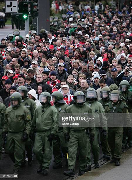 Riot police escort fans of the FC Union Berlin soccer team to the main railway station after FC Union played rivals Dynamo Dresden November 4 2006 in...
