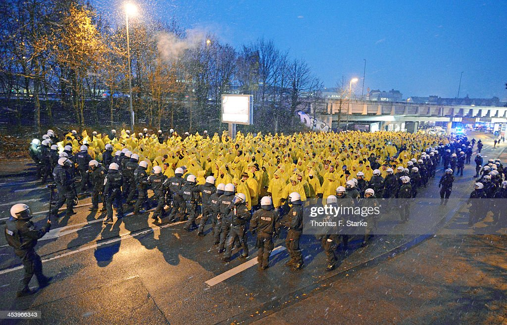 Riot police escort supporters of Dresden on their way to the stadium prior to the Second Bundesliga match between Arminia Bielefeld and Dynamo Dresden at Schueco Arena on December 6, 2013 in Bielefeld, Germany.