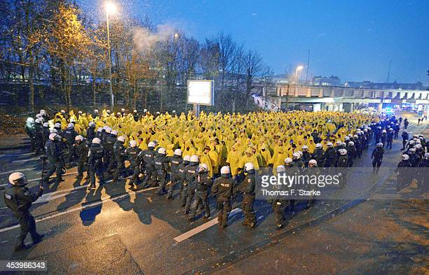Riot police escort supporters of Dresden on their way to the stadium prior to the Second Bundesliga match between Arminia Bielefeld and Dynamo...