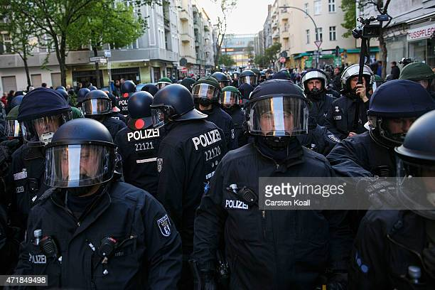 Riot police escorts participants in a 'Revolutionary May 1st' May Day march on May 1 2015 in Berlin Germany Anticapitalist demonstrations on May Day...