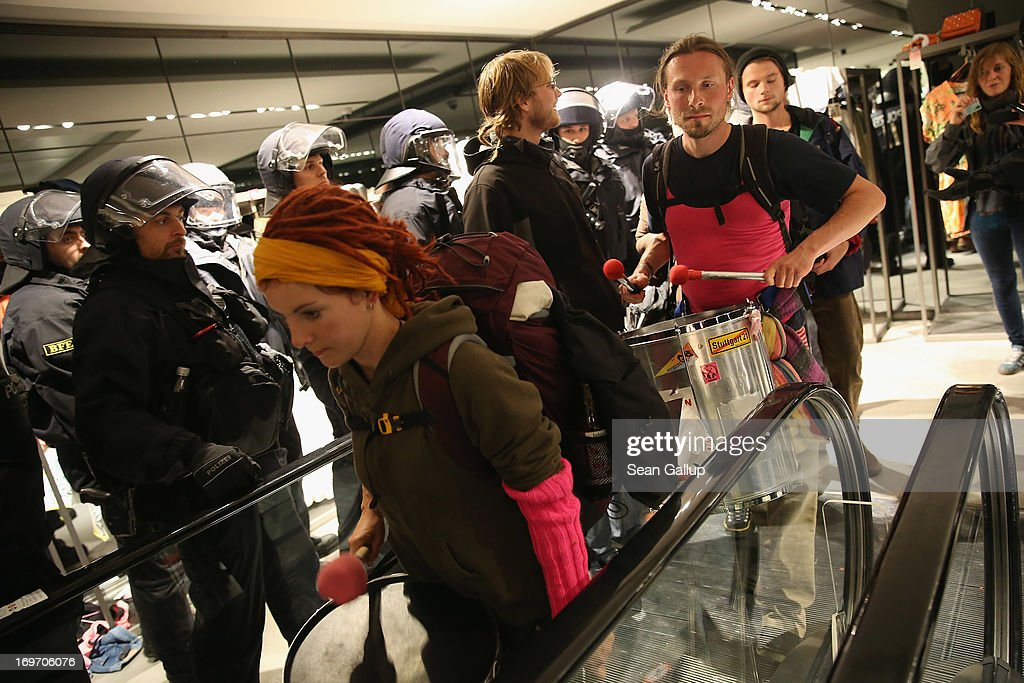 Riot police evict Blockupy protesters who had stormed into a Zara clothing store in the Zeil pedestrian shopping street on May 31, 2013 in Frankfurt am Main, Germany. Several thousand protesters are taking part in Blockupy protests today and tomorrow in Frankfurt in order to demonstrate aginst ECB debt policy, food prices speculation by Deutsche Bank and the labor practices inherent in the discount clothing industry.
