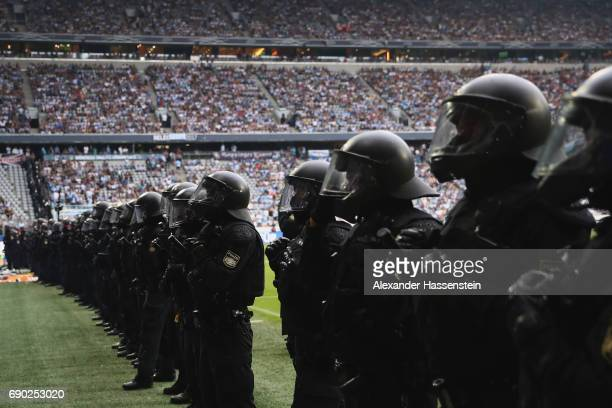 Riot police face 1860 Muenchen fans during the Second Bundesliga Playoff second leg match betweenTSV 1860 Muenchen and Jahn Regensburg at Allianz...
