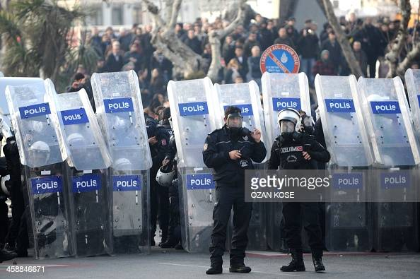 Riot police face demonstrator on December 22 2013 in the Asian side of Istanbul The Istanbul City Demonstration which was planned to denounce the...