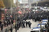 Riot police face Leftist demonstrators protesting against a farright hooligan rally under the banner 'Hooligans against Salafism' at the former...