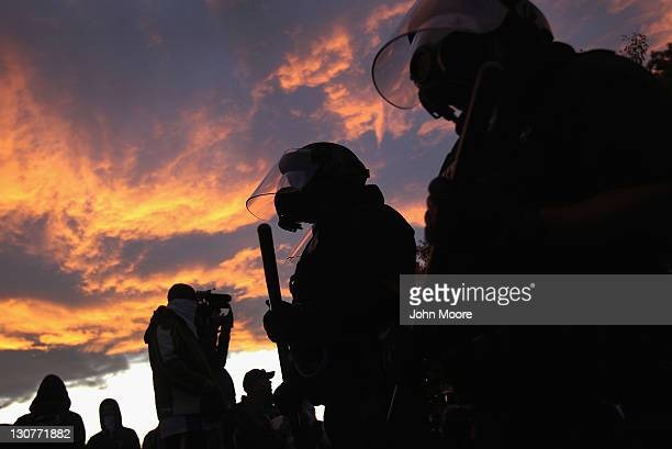 Riot police face off with demonstrators at the 'Occupy Denver' camp on October 29 2011 in Denver Colorado Following a march by protesters police...
