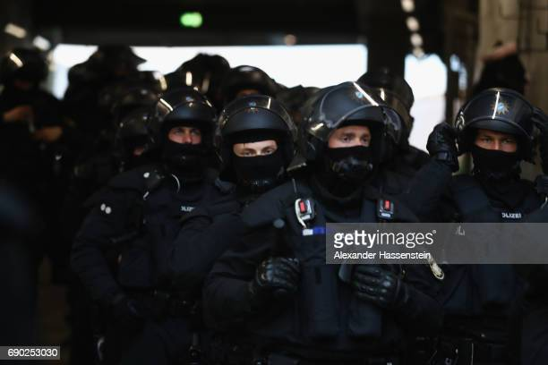 Riot police farrives during the Second Bundesliga Playoff second leg match betweenTSV 1860 Muenchen and Jahn Regensburg at Allianz Arena on May 30...