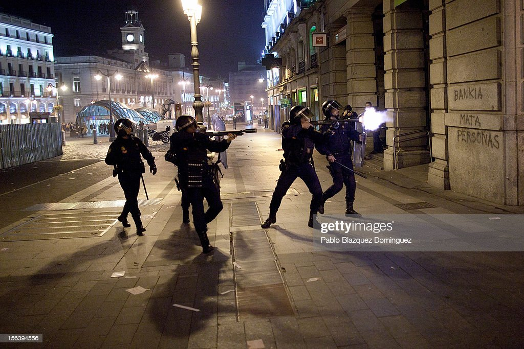 Riot police fire rubber bullets at demonstrators after a protest near the Spanish parliament turned violent on November 14, 2012 in Madrid, Spain. A coordinated general strike by unions in Spain and Portugal has paralysed public transport in the two countries with further strikes planned across Europe. The strike against the governments' austerity measures have force hundreds of flights to be cancelled and factories and ports to come to a standstill.