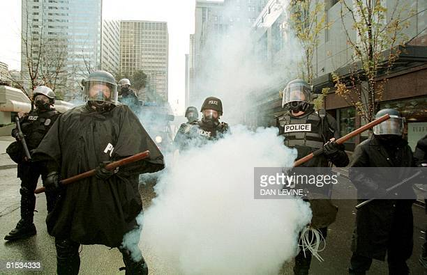 Riot police fire teargas to disperse protesters 30 November 1999 on the first day of the World Trade Organization summit in Seattle The city was...