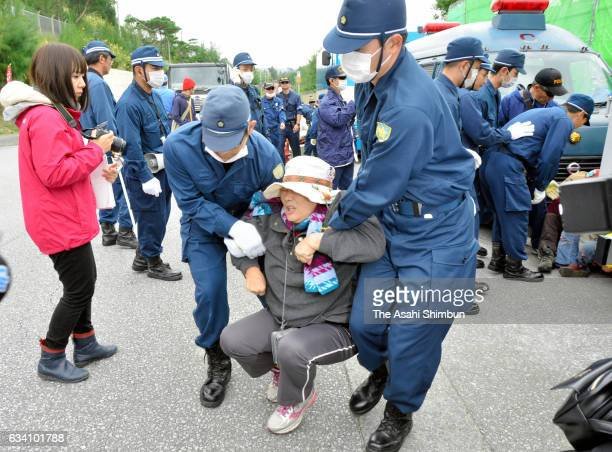 Riot police forcely remove protesters who had staged a sitin to prevent vehicles carrying construction materials from entering Camp Schwab on...