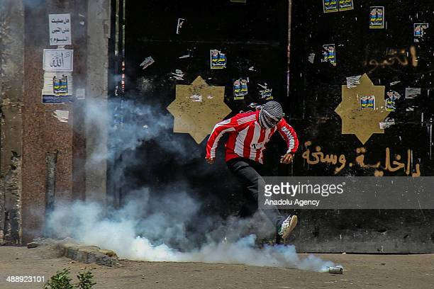 Riot police forces intervene protesters as anticoup Egyptians gather at the Al Azhar University to stage a rally against the government in Cairo...