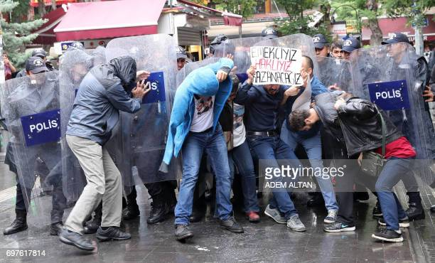 Riot police forces try to disperse protesters demonstrating in support of two hungerstrikers who were taken into custody in May in the Turkish...