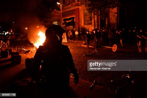 Riot police gather after protesters erected burning barricades in front of the Rote Flora leftwing centre after the 'Welcome to Hell' protest march...