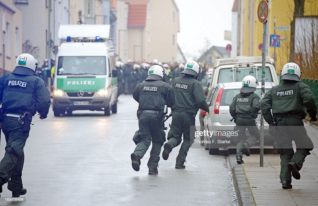 Riot police head for Muenster supporters during the Third League match between Arminia Bielefeld and Preussen Muenster at Schueco Arena on March 9, 2013 in Bielefeld, Germany.