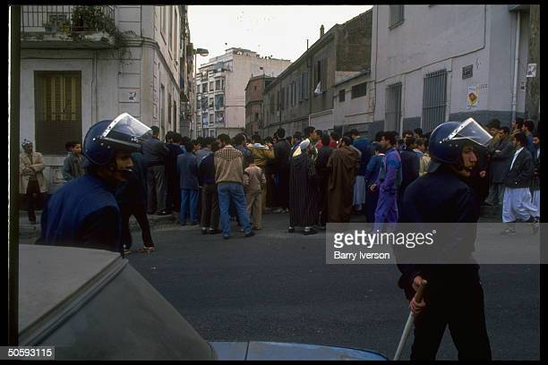 Riot police in street as Moslem supporters of opposition Islamic Salvation Front attend prayers in elections victorious FIS stronghold