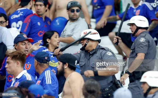 Riot police intervene the Universidad de Chile fans during the Copa Sudamericana match between Corinthians and Universidad Chile at the Arena...