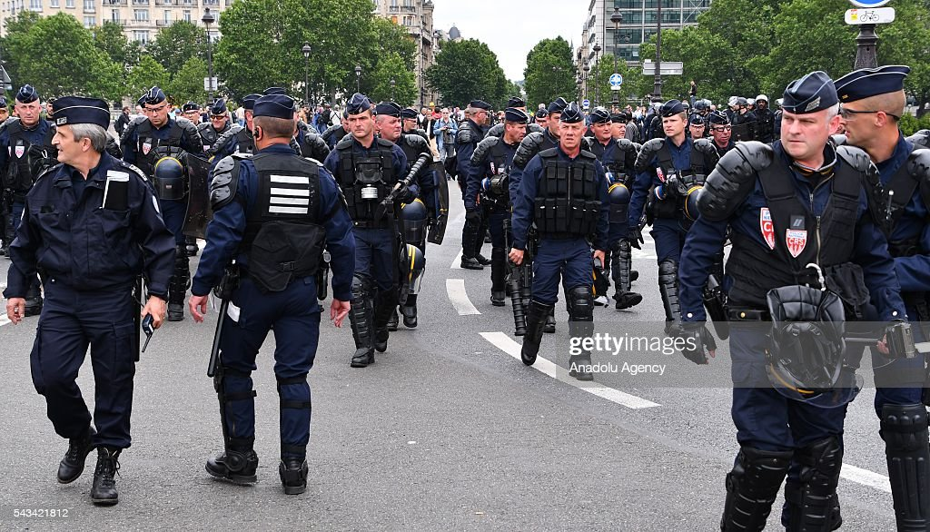 Riot police intervene to the protesters during a protest against the new labor law also known as the 'El Khomri law' which has recently proposed by Labor Minister Myriam El Khomri in Paris, France on June 28, 2016. Country-wide protests and strikes, led by uniuons has been continuing for weeks.