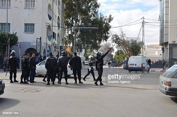 Riot police intervene to the protesters during a protest staged by unemployed young citizens against unemployment and poverty in Tataouine Tunisia on...