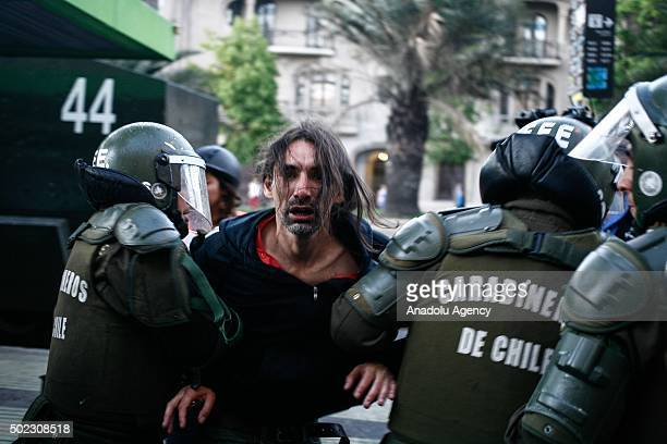 Riot police intervene to the students during a protest demanding free education and against government's policies in Santiago Chile on December 22...