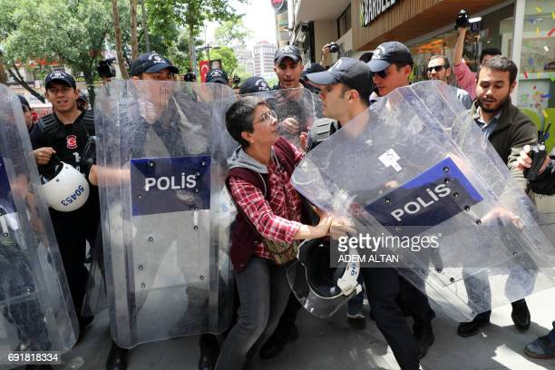 TOPSHOT Riot police interveneS to stop protesters demonstrating in support of two hungerstrikers who were taken into custody in May in the Turkish...