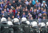 Riot Police line up infront off the guest sector during the Third League match between Preussen Muenster and VfL Osnabrueck at Preussenstadion on...