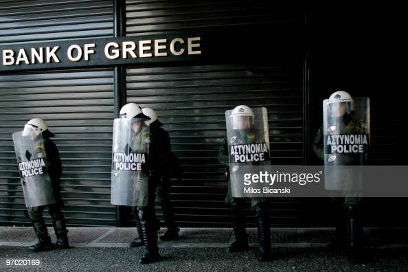 Riot police line up outside a closed branch of the National Bank of Greece during a 24hour general strike on February 24 2010 in Athens Greece Greece...