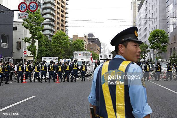 Riot Police make a barricade to protect the both marches of right wing and left wing A group of right wing cars are stopped by the police on August...
