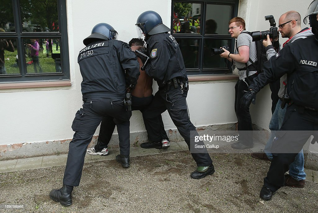 Riot police make an arrest during the main Blockupy demonstration in the financial district on June 1, 2013 in Frankfurt am Main, Germany. Thousands of protesters are marching to demonstrate against capitalism, European Central Bank debt policy and the exploitation of textile workers in Third World countries, among other issues.