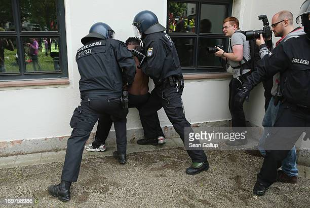 Riot police make an arrest during the main Blockupy demonstration in the financial district on June 1 2013 in Frankfurt am Main Germany Thousands of...