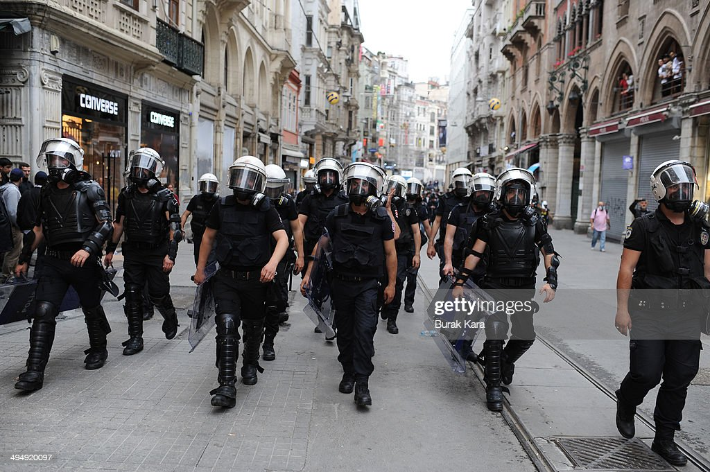 Riot police march to disperse anti-government protesters in central Istanbul May 31, 2014. Turkish police on Saturday used tear gas in central Istanbul to disperse protesters seeking to mark the one-year anniversary of the start of the biggest anti-government demonstrations in decades. Several hundred people gathered on streets leading to Taksim Square, shouting for the government's resignation, when police fired teargas at the crowd, which quickly scattered.