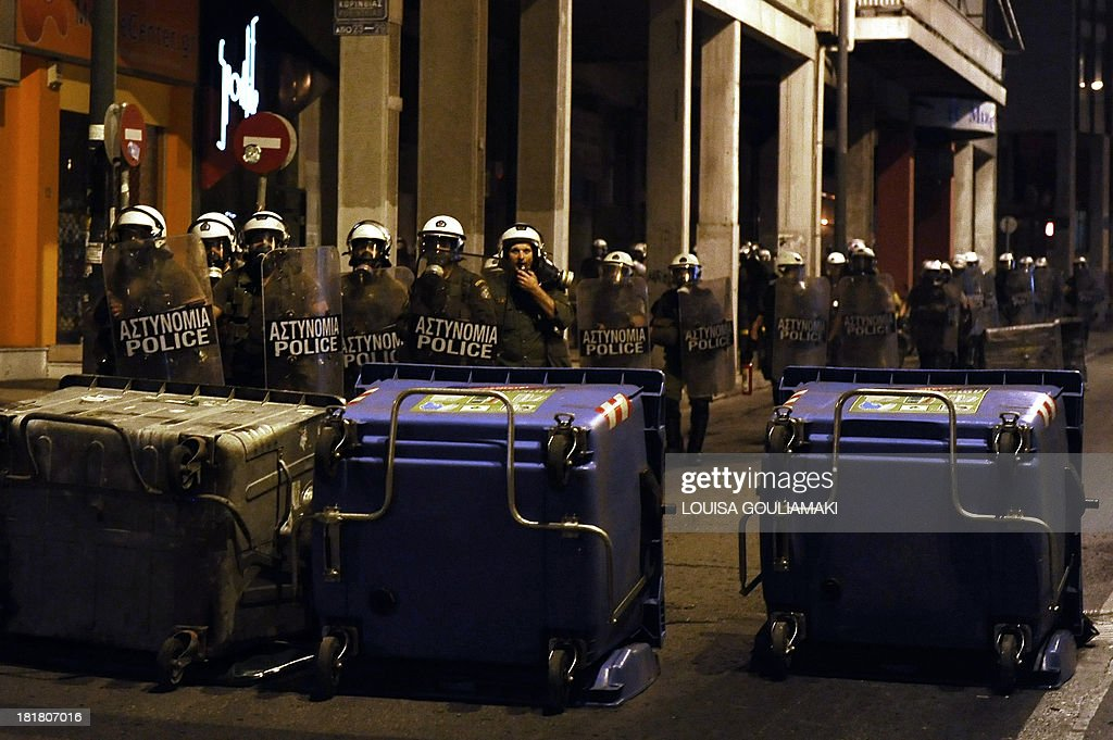 Riot police move toward barricades left by protesters on September 25, 2013 after a massive demonstration in Athens. Greek police clashed with protesters in Athens late September 25 at the end of a huge march sparked by the murder of an anti-fascist musician, allegedly at the hands of a self-confessed neo-Nazi. Protesters were seen hurling petrol bombs at riot police, who responded with tear gas a few hundred meters (yards) from the headquarters of the neo-Nazi party Golden Dawn.