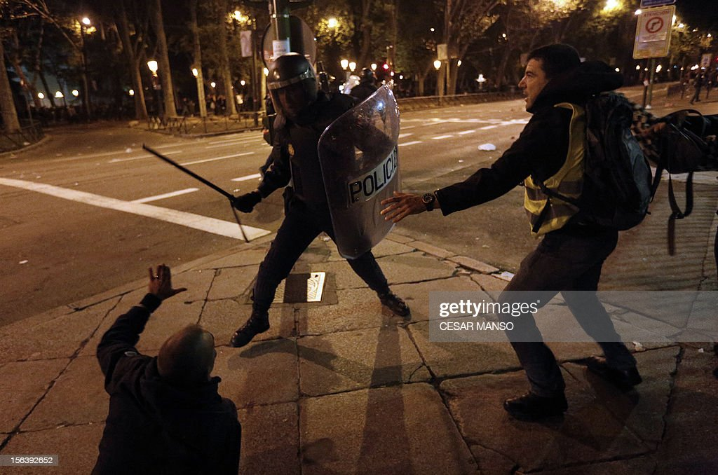 A riot police officer clashes with protesters at the end of a demonstration organized by Spain's 'indignant' protesters, a popular movement against a political system that they say deprives ordinary Spaniards of a voice in the crisis, near the parliament building in Madrid during a general strike. The second general strike this year hit Spain with protesters marching in several cities against sweeping austerity measures and high unemployment, scenes echoed elsewhere in Europe. Spain, the eurozone's fourth-biggest economy, is suffering 25 percent unemployment, with the rate even higher amongst young people.